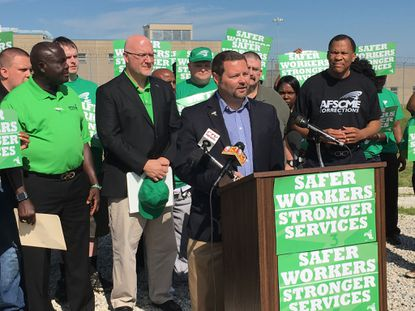 Several dozen AFSCME members and officials gathered outside the Dorsey Run Correctional Facility in Jessup for a news conference at which they blamed Gov. Larry Hogan for what they called a dangerous level of understaffing.