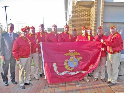 Members of the Harford Detachment of the Marine Corps League prepare to raise the Corps flag in front of the Harford County government building in Bel Air early Friday morning in recognition of the Marine Corps' 237th birthday. More local Veterans Day observances are planned for Sunday and Monday and later in the week.