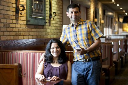 Wife and husband Beena (left) and Ashish Bakshi created the MyCustomCoupon app, which has expanded from Howard County to Baltimore and Towson.