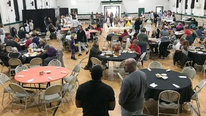 An estimated 120 guests enjoyed an early Thanksgiving dinner Sunday afternoon during Hope in Action's ninth annual community dinner at the Bel Air Armory.