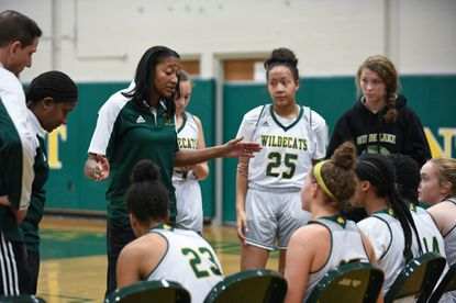Wilde Lake's head coach Rhonda Corkeron, pictured here talking to her team during a timeout against Glenelg Country School on Dec. 6, coached the Wildecats to their first county triumph since the 2016-17 season with a 36-31 win over Glenelg on Wednesday, Dec. 11.