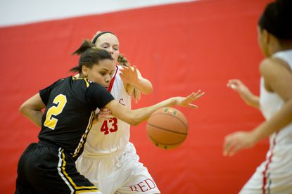 St. Frances' Mia Davis, left, and Roland Park's Anna Hauser battle for the ball during the girls basketball game at Roland Park Country School on Jan.2.