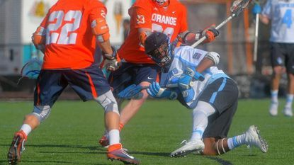 Johns Hopkins midfielder Daniel Jones (below) looks for an open teammate while surrounded by Syracuse attack Jordan Evans (22) and midfielder Nick Mariano during the first quarter at Homewood Field in 2017.
