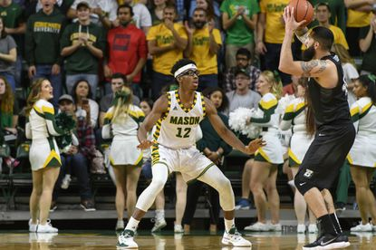 Men's Basketball vs Binghamton Laurel resident AJ Wilson is averaging over 12 minutes off the bench at George Mason University. He had a career-high eight blocked shots against Cal State-Northridge. photo by Rafael Suanes
