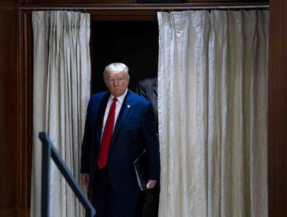 President Donald Trump arrives for a news conference in New Delhi, India. Republican lawmakers in Baltimore County are upset over a lesson in an AP History class at Loch Raven High School that included images of President Donald Trump and Nazi and communist symbolism.