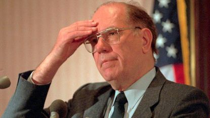 In this Feb. 3, 1994, file photo, Lyndon LaRouche gestures during a news conference in Arlington, Va.