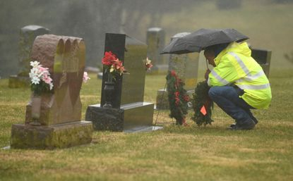 Mike Kreimer of Walkersville places a wreath on a grave marker during a previous year's Wreaths Across America event at Pipe Creek Cemetery in Union Bridge. This year's event will be Saturday, Dec. 14 at noon.