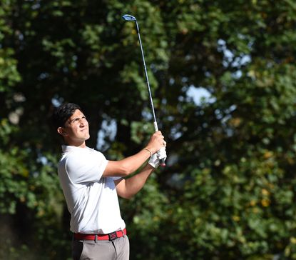 Fallston golfer Will Creery watches his shot sail to the green on the ninth hole during Tuesday's Harford County Golf championship at Geneva Farm Golf Course.