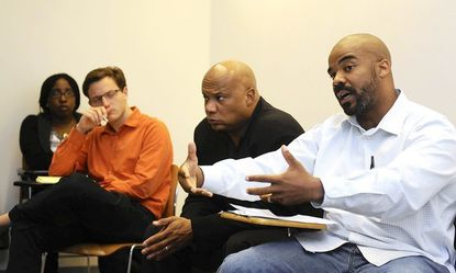"Nathan Connolly, right, an assistant professor of history at Johns Hopkins University, participates in ""Beyond Trayvon,"" a discussion group held this afternoon at Johns Hopkins University. Michael Hanchard, a political science professor, is next to him on left."