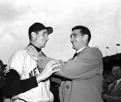 "In this Oct. 10, 1951, file photo, Bobby Thomson, left, of the New York Giants, and Ralph Branca of the Brooklyn Dodgers, engage in horse play before a World Series game at Yankee Stadium in New York. Branca, the Brooklyn Dodgers pitcher who gave up the home run dubbed the ""Shot Heard 'Round the World,"" has died at the age of 90. His son-in-law Bobby Valentine, a former major league manager, says Branca died Wednesday, Nov. 23, 2016, at a nursing home in Rye, New York."