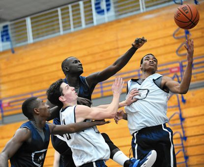 From left, Byron Ashe, Will Miller, Mawdo Sallah and Chris Wray try to bring down a rebound during a scrimmage at Mount St. Mary's in Emmitsburg Oct. 22.