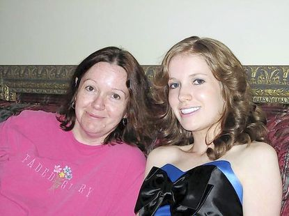 "Cathy Garger sits with her daughter, Jennifer ""Jenny"" Michelle Olenick, before the Marriotts Ridge High School prom in May 2009."