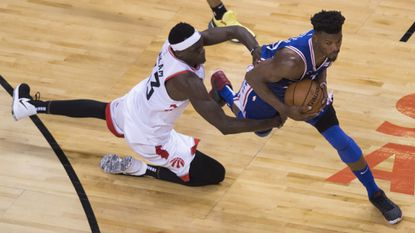Toronto Raptors forward Pascal Siakam, left, fouls Philadelphia 76ers guard Jimmy Butler during the second half of Game 2 of the NBA Eastern Conference semifinals on April 29.