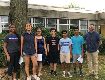 Dulaney High School students, from left, Sreesaisowmya Potluro, Victoria Jin, Sarah Shen, Benjamin Yin, Gautam Maybhate and Mir Saif Hossain are National Merit Scholarship semifinalists. School counselor John Komosa is on the right.
