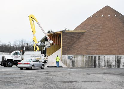 Road salt fills a salt dome along Route 40 at Short Lane in Aberdeen in preparation for the upcoming snowstorm, as performed some maintenance Wednesday afternoon.