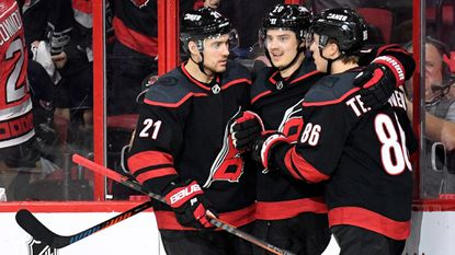 Teuvo Teravainen (86) celebrates with Nino Niederreiter (21) and Sebastian Aho (20) of the Hurricanes after scoring a goal against the Capitals in the second period of Game 6 of the Eastern Conference first round during the Stanley Cup playoffs at PNC Arena on April 22, 2019.