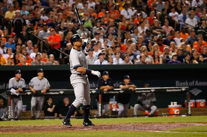 Alex Rodriguez of the New York Yankees follows his two-run home run in the sixth inning against the Orioles at Camden Yards on June 13, 2015 in Baltimore. The hit gave Rodriguez 2,001 career RBIs and 2,995 hits.