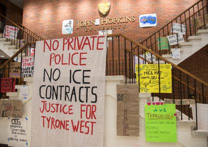 Signs cover the walls inside of Garland Hall during the sit-in. At Johns Hopkins University, a group of students sat in the university's administration building for weeks as part of their protest against private police.