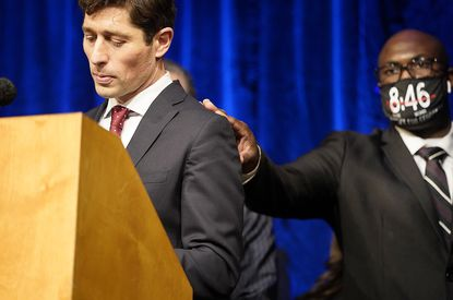 Philonise Floyd, George's brother, placed his hand on the shoulder of Minneapolis mayor Jacob Frey as Frey walked to the podium to speak during a press conference to announce a $27 million civil lawsuit settlement between the Floyd family and the City of Minneapolis Friday, March 12, 2021, in Minneapolis. (David Joles/Star Tribune via AP)