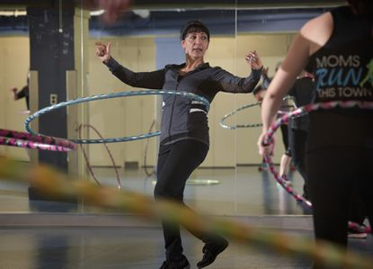 Columbia resident Simin Khosraviana leads a Hula Hoop cardio class at the Columbia Athletic Club on a recent Saturday morning.