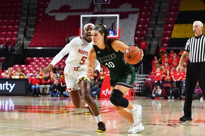 Loyola Maryland's Stephanie Karcz drives against Maryland during a game in College Park on Nov. 8, 2019.