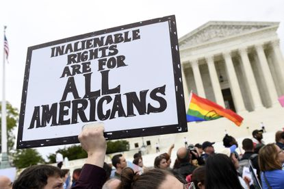 In this Oct. 8, 2019, file photo, protesters gather outside the Supreme Court in Washington where the Supreme Court is hearing arguments in the first case of LGBT rights since the retirement of Supreme Court Justice Anthony Kennedy. LGBT-rights activists are looking ahead as they celebrate a major victory in the Supreme Court regarding job discrimination, They hope the June 15, 2020, decision spurs action against other forms of bias against their community and undermines the Trump administration's near-total ban on military service by transgender people. (AP Photo/Susan Walsh, File)