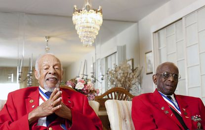 Lemuel Lewis Jr., left, and Dr. Cyril Byron Sr. pose for a portrait at Lewis' home in Windsor Mill. The two are Tuskegee Airmen who will be co-grand marshals in the Towson Fourth of July Parade. The Tuskegee Airmen were the first black military airmen, and served during World War II.