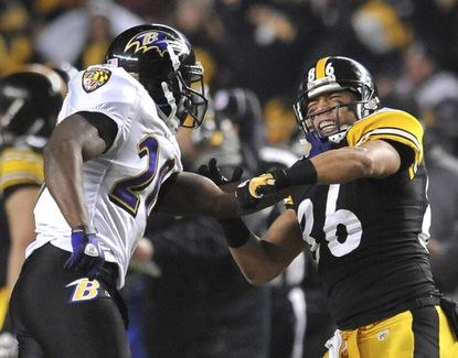 Ravens safety Ed Reed and Steelers wide receiver Hines Ward get physical in the second half of their 2011 divisional-round playoff game.