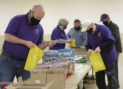 From left, Scott Walthour, Carol Neff, Jerry Apricella, Bob Hodgkiss and Bruce Edwards of the Freedom District Lions Club gather at the Freedom Optimist Hall in Eldersburg to assemble care bags to be distributed to workers at Carroll Hospital Friday, Feb. 26, 2021. The group prepared more than 350 of the bags to be distributed primarily among night and weekend staff at the hospital in appreciation for their work.