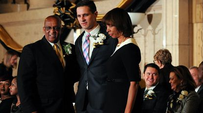 """City Councilman Ryan Dorsey, center, stands with now-Mayor and then-City Council President Bernard """"Jack"""" Young, left, and then-Mayor Catherine Pugh at the swearing-in ceremony of the 72nd Baltimore City Council in December 2016."""