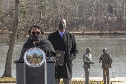 Denise Boston, pictured here talking during a press conference in January, was hired by Howard County Executive Calvin Ball, back, as the county's first equity and restorative practices manager. (Staff/Baltimore Sun Media).