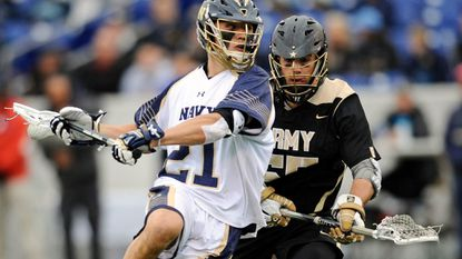 Casey Rees, now a senior midfielder for the Navy men's lacrosse team, prepares to shoot during a 2016 Patriot League Semifinals against Army West Point held at the Navy-Marine Corps Memorial Stadium in Annapolis.