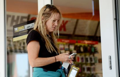 Jennifer LaFleur, of Homeland, sporting an original iPhone, showed up before 9 a.m. Friday at the Radio Shack in Towson to get an iPhone 5, only to learn that the store had not yet received its shipment.