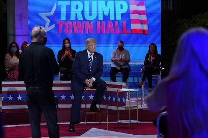 President Donald Trump sits during a break in an NBC News Town Hall, at Perez Art Museum Miami, Thursday, Oct. 15, 2020, in Miami.
