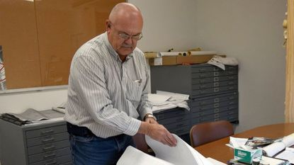 Retiring Manchester Public Works Director Donnie Nott reviews construction plans for a local business Wednesday Nov. 7, 2018.