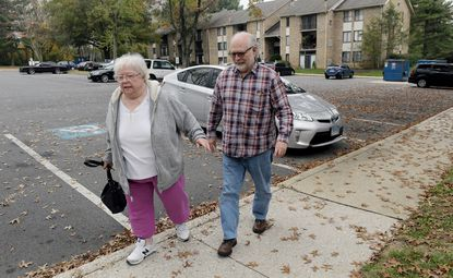 Irma Hardy, of Columbia, walks to her home Oct. 30 as Steve Lockhart, a volunteer for Neighbor Ride, takes a few steps with her after dropping her off after her appointment. Hardy is depending on lifts from the nonprofit ride service for seniors three times a week for three months. Lockhart has volunteered twice a week for two and a half years.