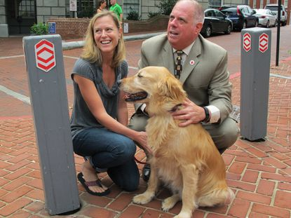 Gov. Larry Hogan pauses to greet Boulder, whose owner, Lori Gross, said has lymphoma. Hogan had just signed an executive order that renews the state's Council on Cancer Control. Hogan also said he remains cancer-free in his own battle against non-Hodgkin's lymphoma.