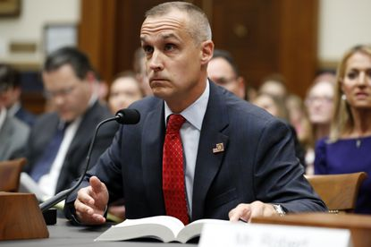 Corey Lewandowski, former campaign manager for President Donald Trump, references a copy of the Mueller Report that he requested, as he testifies to the House Judiciary Committee Tuesday in Washington.