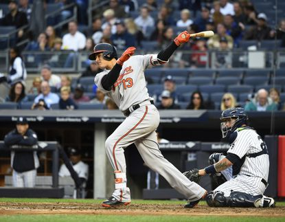 Orioles' Manny Machado singles against the New York Yankees in the sixth inning of a baseball game, Sunday, Oct. 2, 2016, in New York.