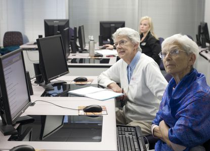 """Marcia Sartwell (left) and Marcia Rucker attend the class """"90 Minutes to Getting Started in Twitter"""" at Howard Community College's Gateway campus. Sartwell said she plans to use Twitter to market her new book."""