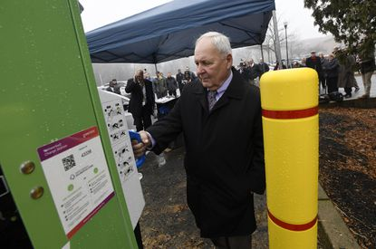 Carroll County Commissioner Richard Weaver takes a look at a Level 3 DC Fast Charger during a ribbon cutting ceremony to unveil the charging station installed by BGE at the Carroll County Office Building in Westminster Tuesday, Dec. 17, 2019.