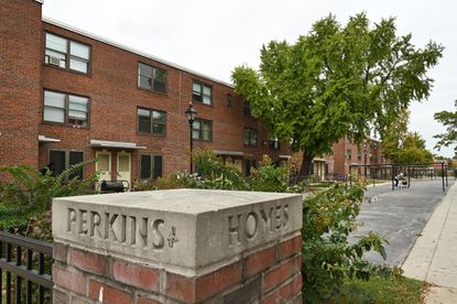 A Baltimore police officer is accused of coughing at residents at Perkins Homes in Baltimore.