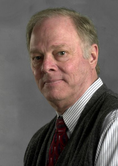 Mike Lane, pictured in 2002, drew editorial cartoons on the op-ed pages of The Evening Sun and The Sun from 1972 to 2004.