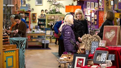 Women shop at Artcraft during Historic Savage Mill's Girls Night Out.