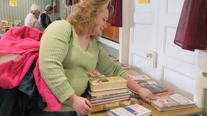 Michelle Johnson, of Manchester, searches through the cookbooks at the Day of Knowledge Book Fair at the Millers United Methodist Church in 2015. This year's event is set for Jan. 19.