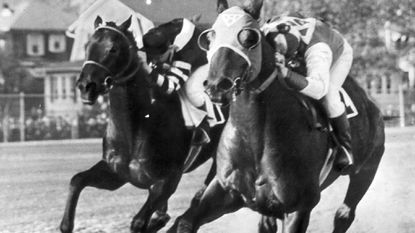War Admiral, left, and Seabiscuit race in the 1938 match at Pimlico.