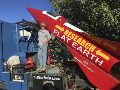 Daredevil/limousine driver Mad Mike Hughes with his steam-powered rocket constructed out of salvage parts on a five-acre property in Apple Valley, Calif.