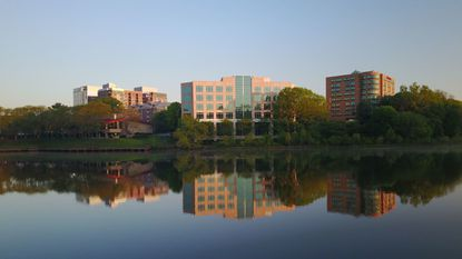 Office buildings reflect in Lake Kittamaqundi near Columbia's town center.