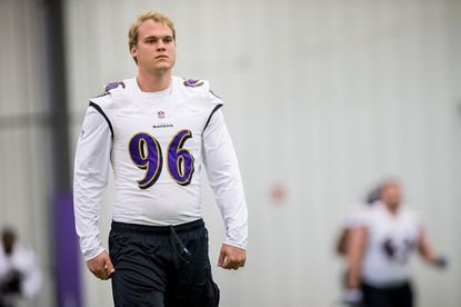 Defensive end Brent Urban, out of Virginia, participates in the first week of Ravens' rookie minicamp.