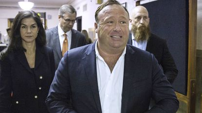 "In this 2017 photo, ""InfoWars"" host Alex Jones arrives at the Travis County Courthouse in Austin, Texas, in connection with a defamation suit filed by families of people killed in the 2012 Sandy Hook school shooting. Last week, several major internet sites dropped his content."